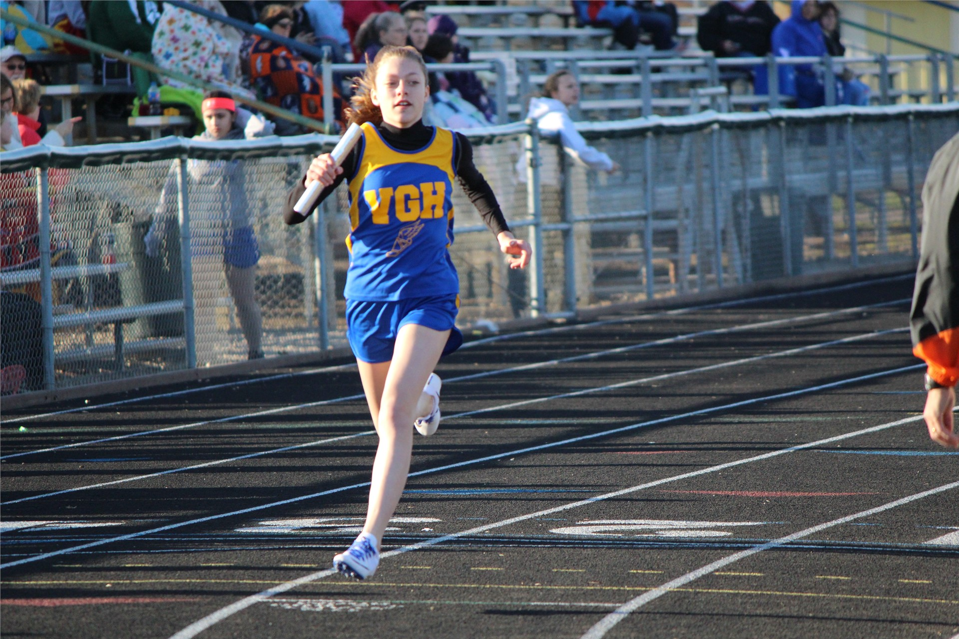 Girl running in track