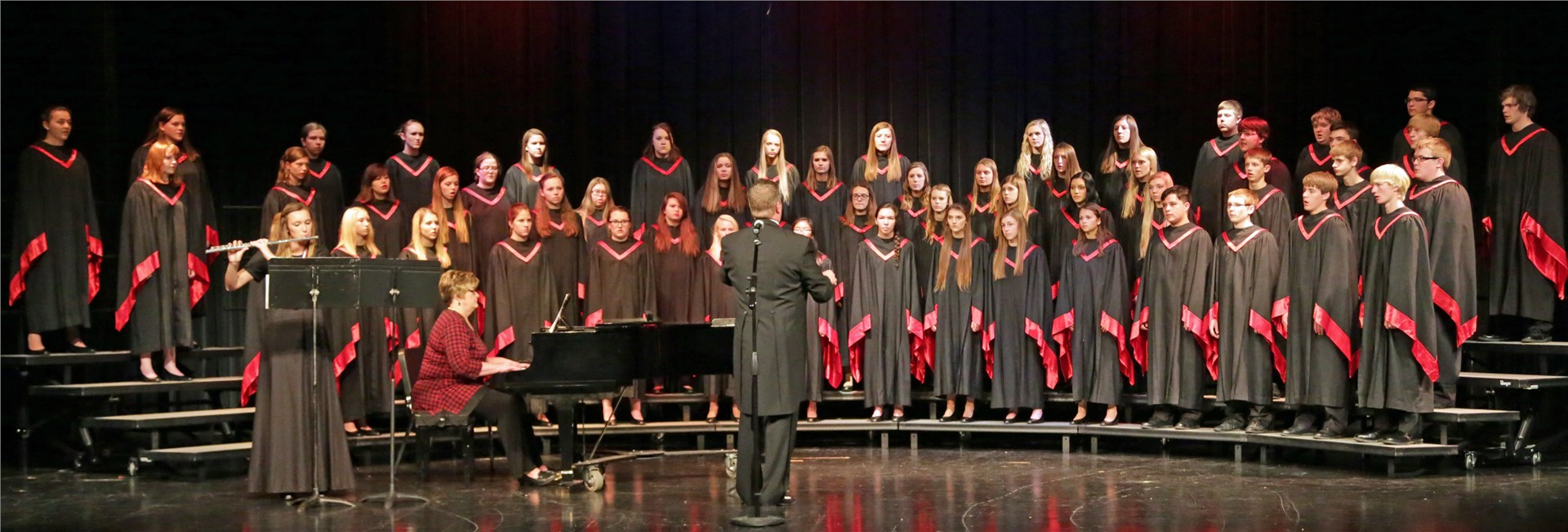 High school student choir singing on risers