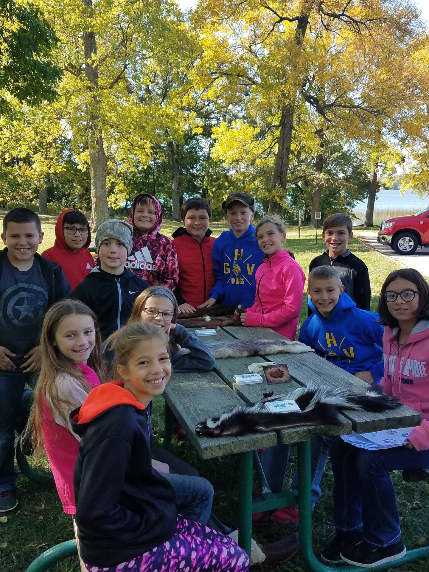 5th grade GHV students sitting at a picnic table identifying furs for DNR Day
