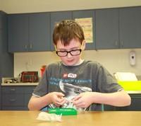 Boy doing shape puzzle