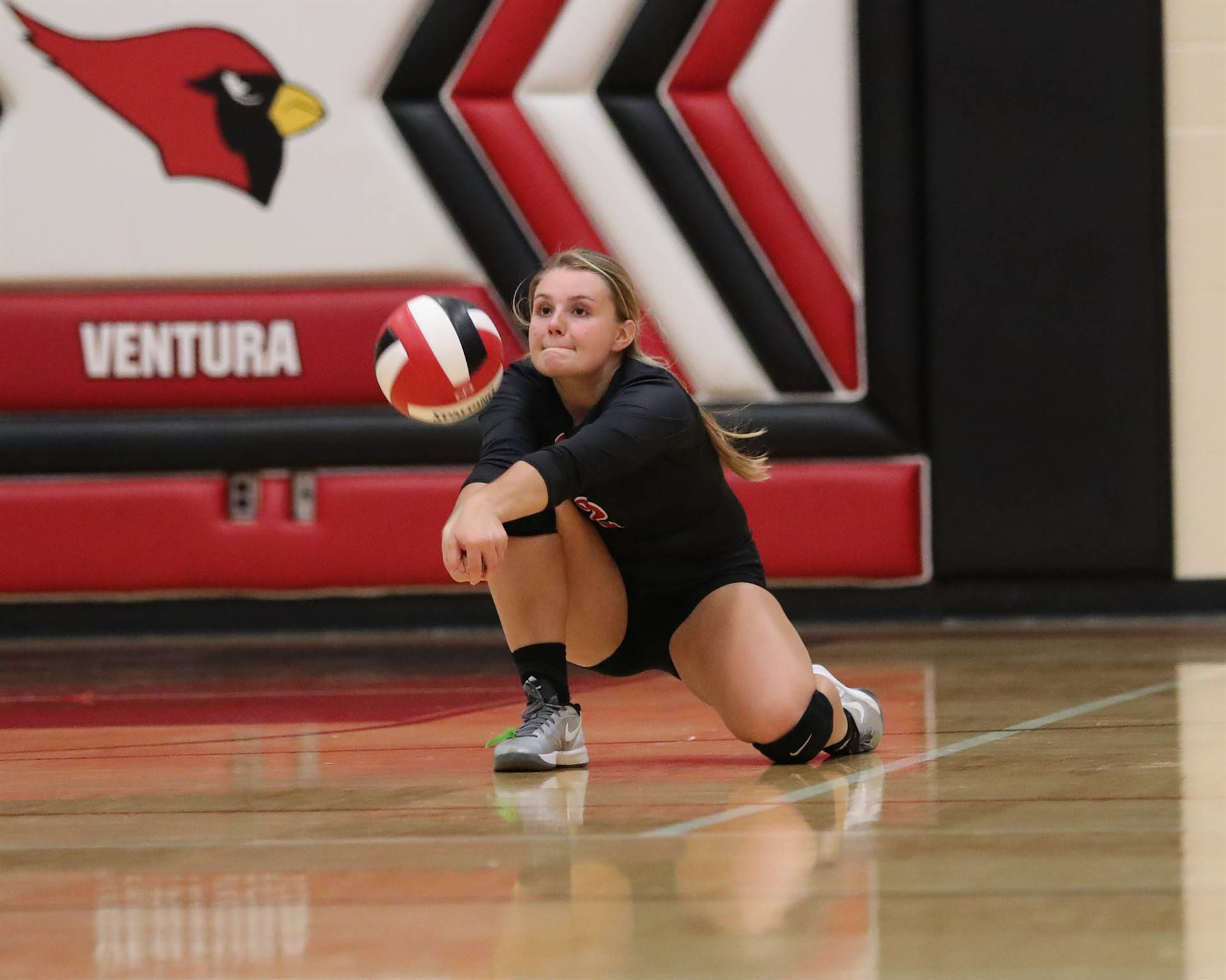 GHV High School volleyball player digging the volleyball during serve reception