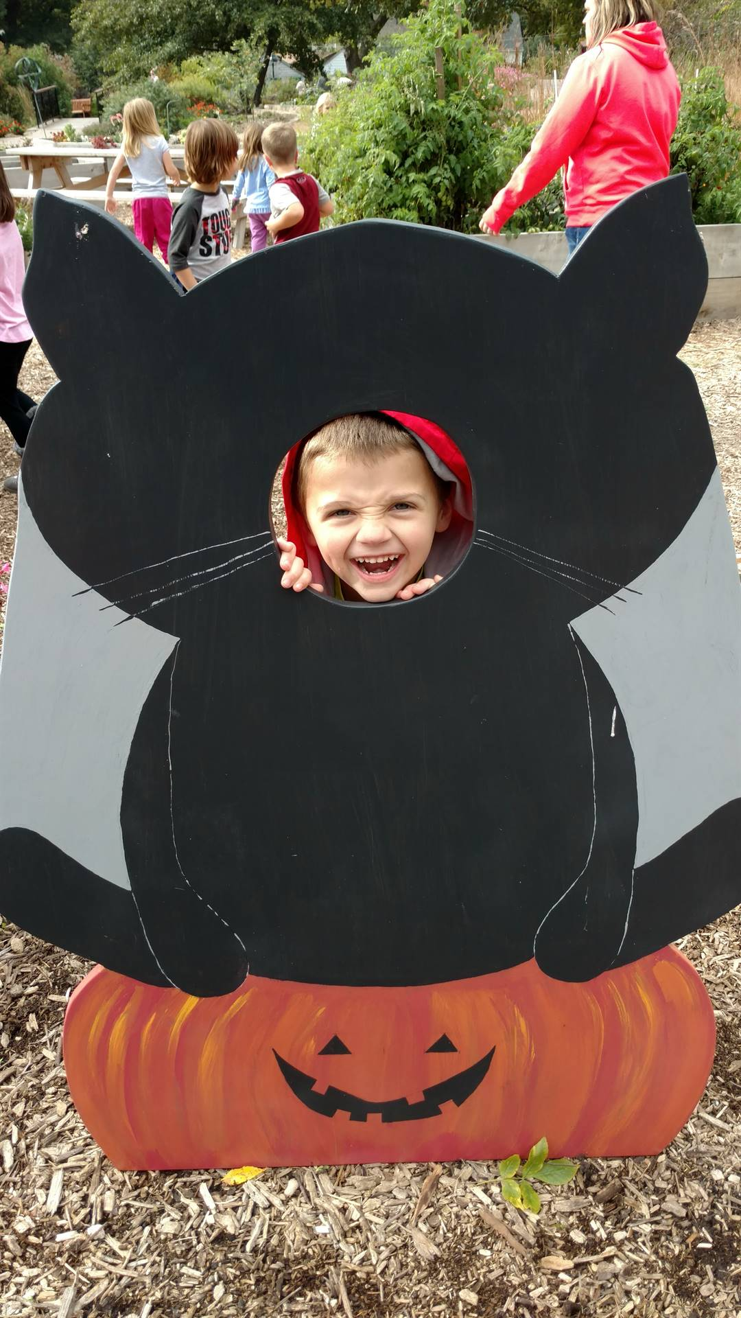 Student posing in a black cat photo display