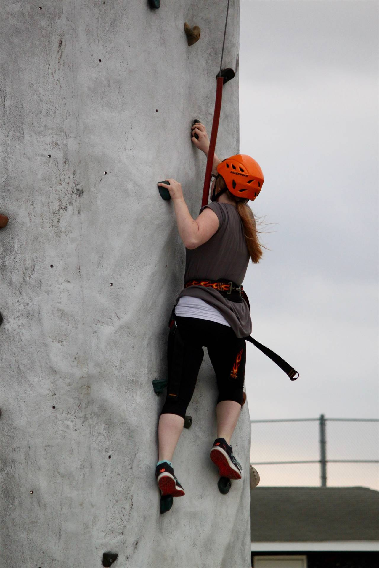 GHV student climbing rock wall in physical education class