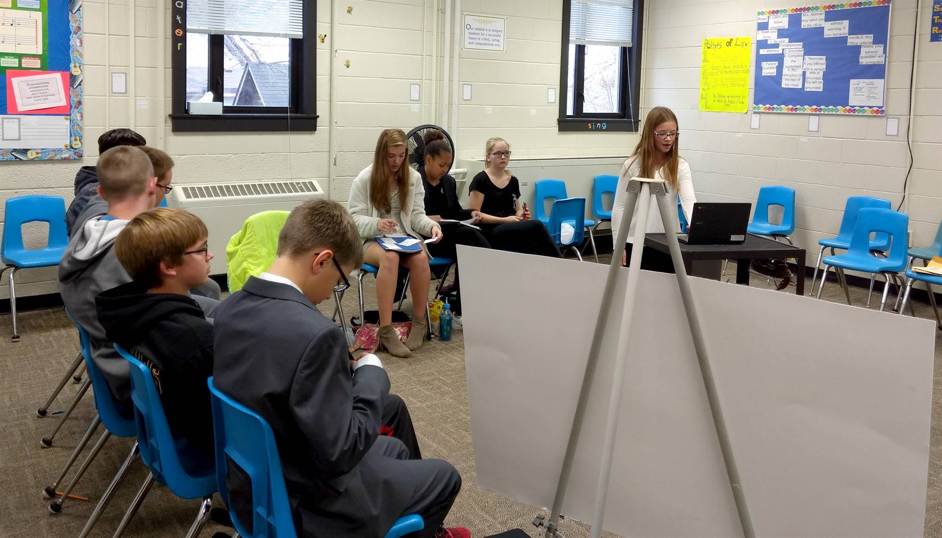 A group of students practicing for a Mock Trial competition