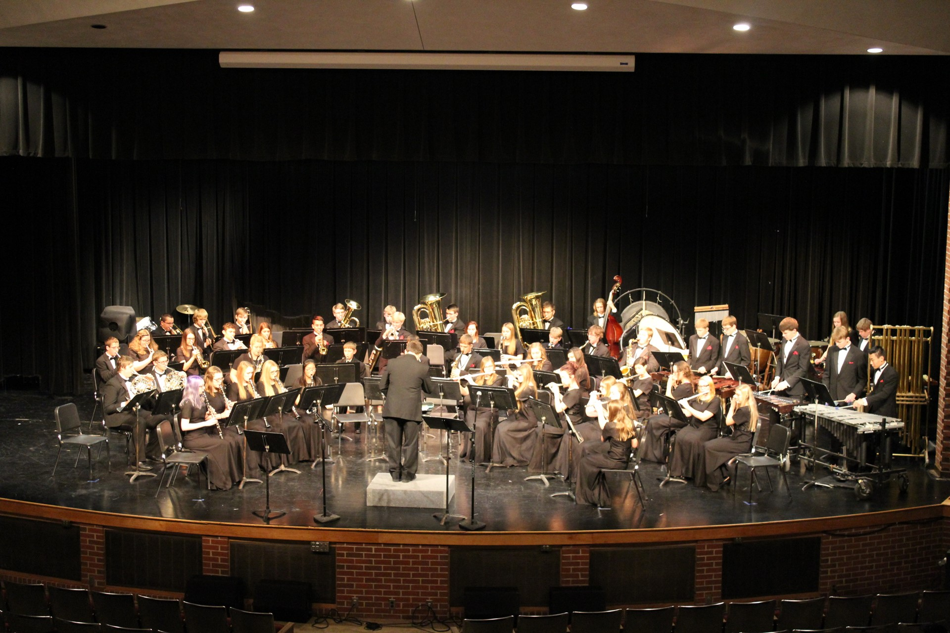 High school concert band playing on stage