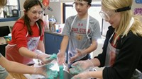 Students conducting an experiment in science class