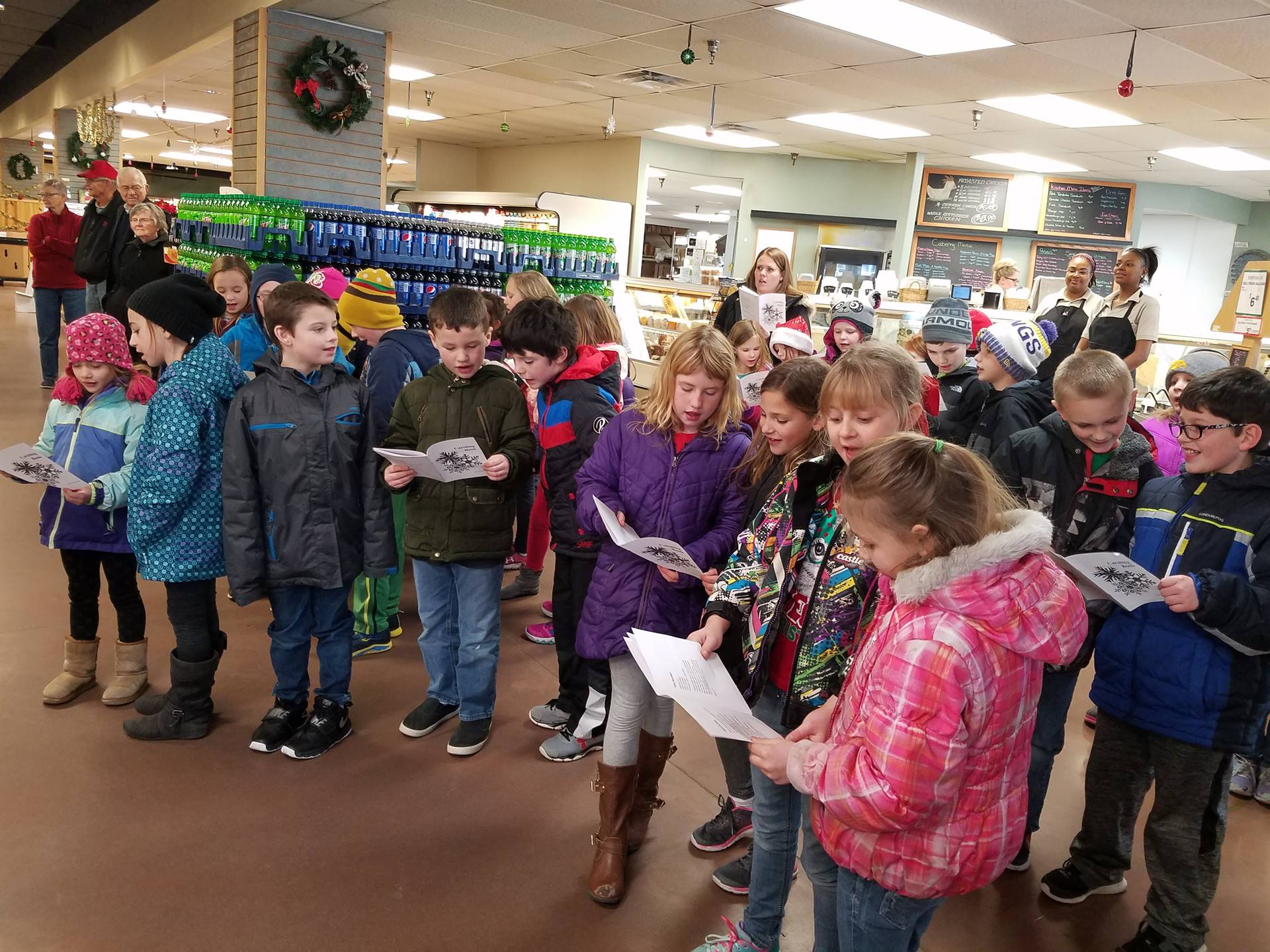 students singing in the grocery store
