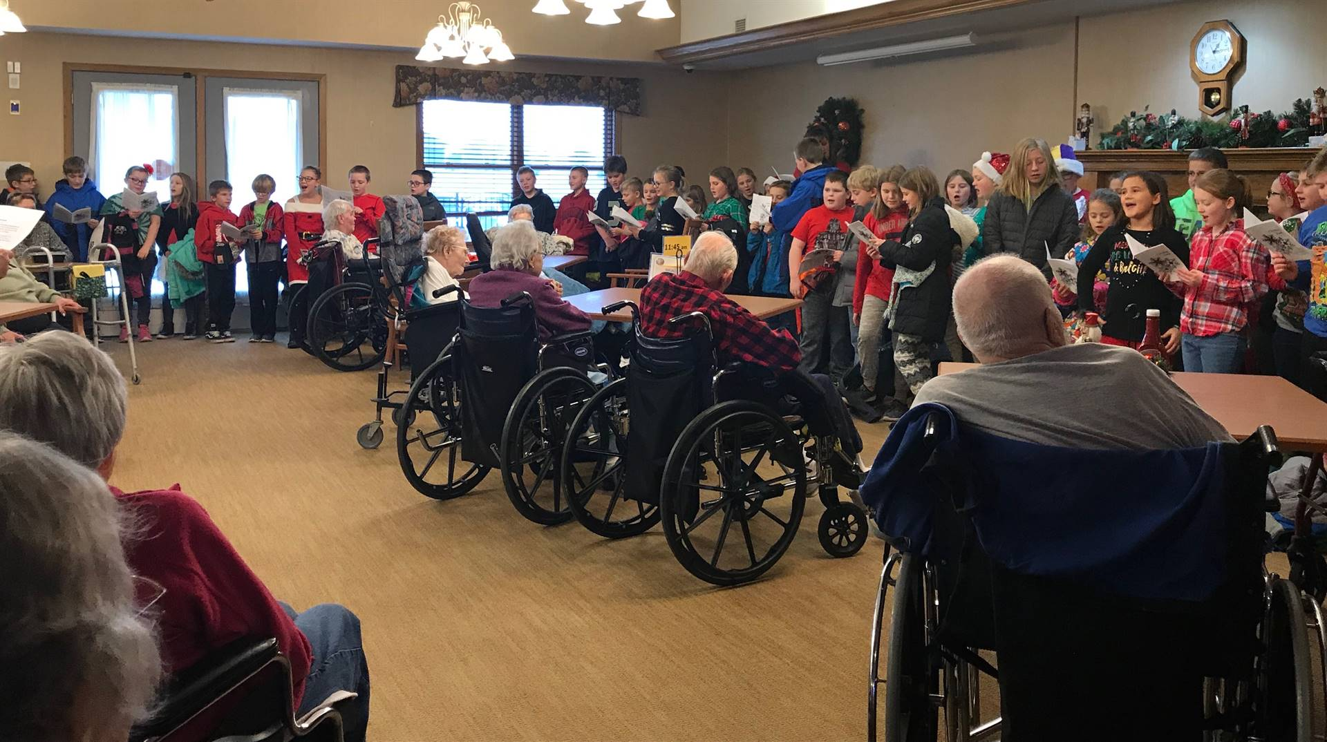 students singing Christmas carols at the local nursing home