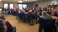 students singing at the local nursing home
