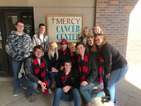 Students posing for a photo near Mercy Cancer Center