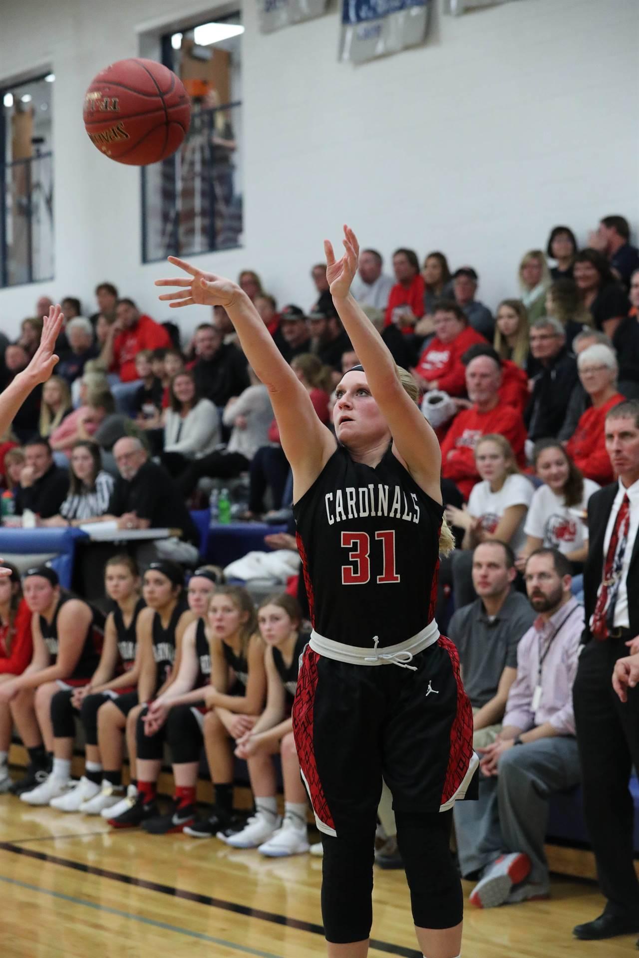 High School Girls Basketball Player shoots basketball