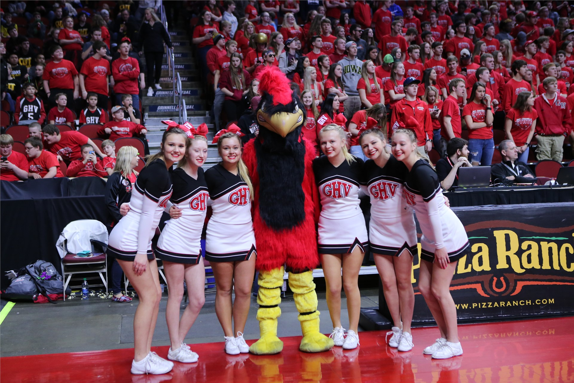 Cheerleaders posing with Cardinal mascot