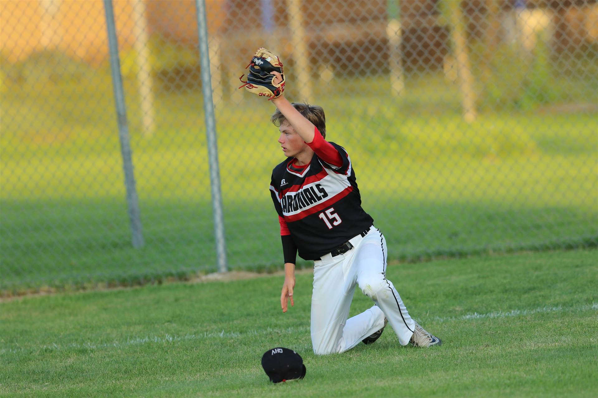Baseball player making a catch in the outfield