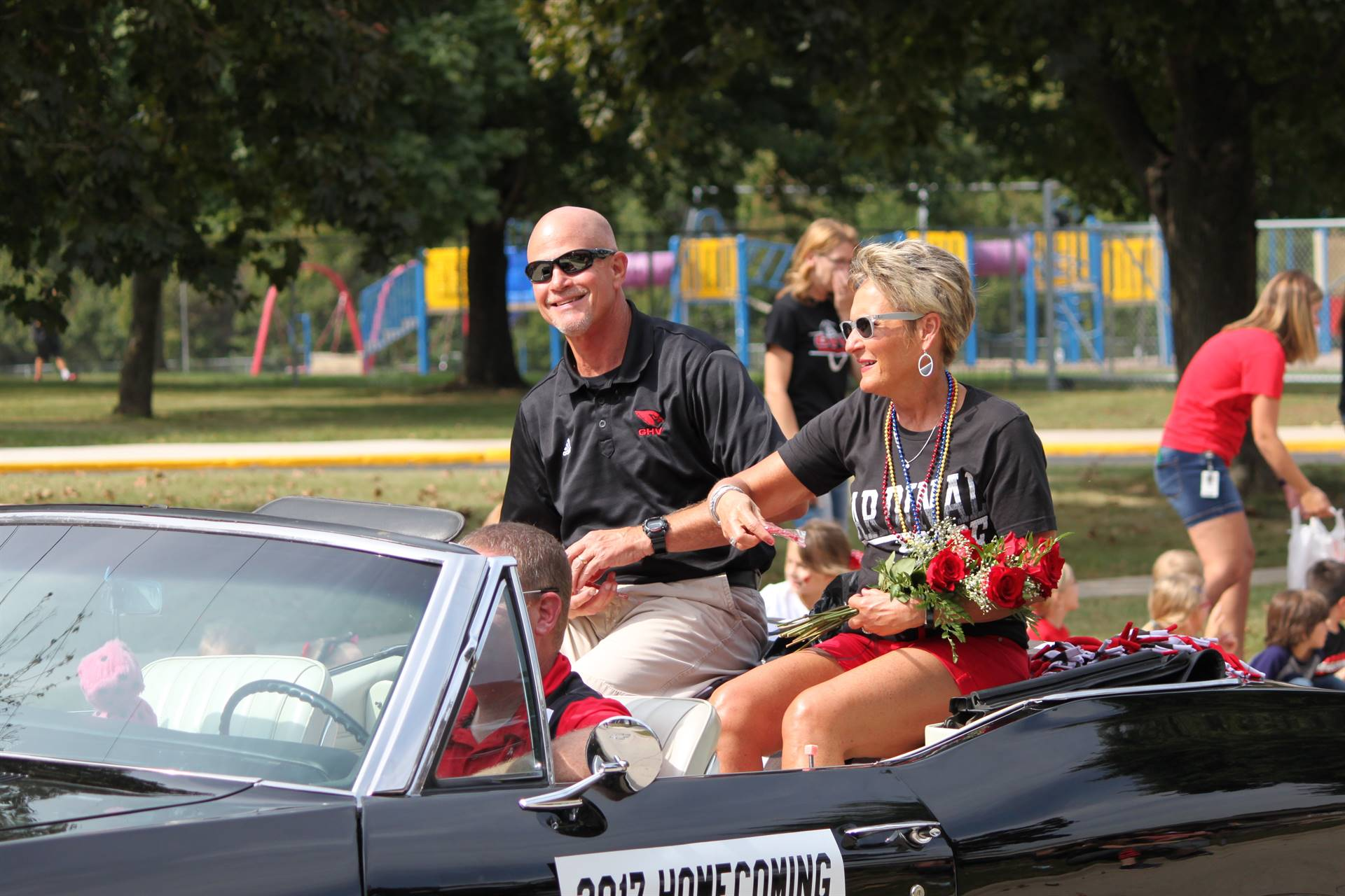 2017 Homecoming Parade marshals riding in convertible