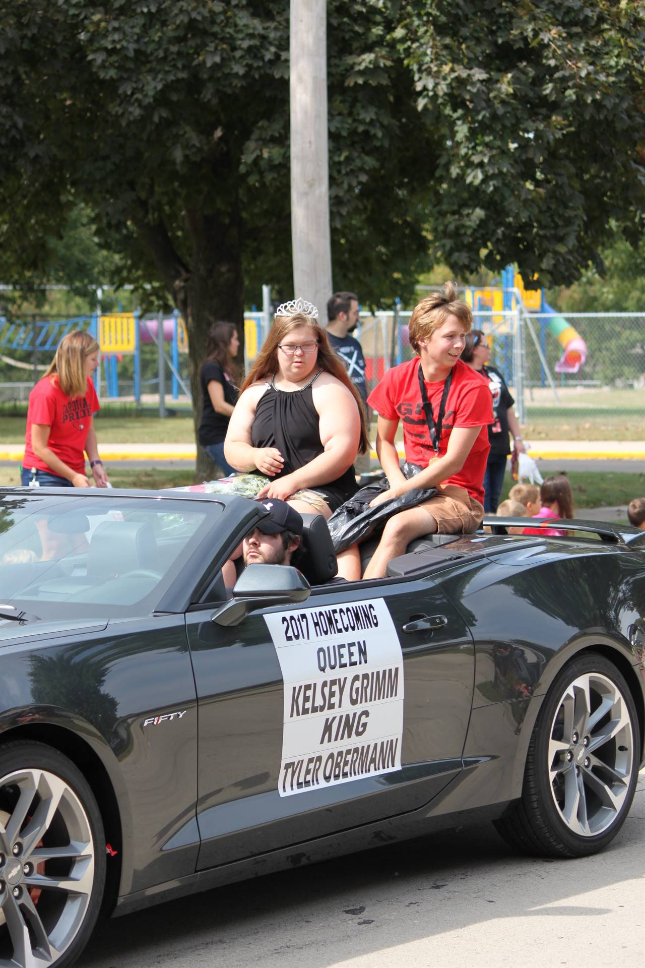 2017 Homecoming king and queen riding in a convertible for the homecoming parade