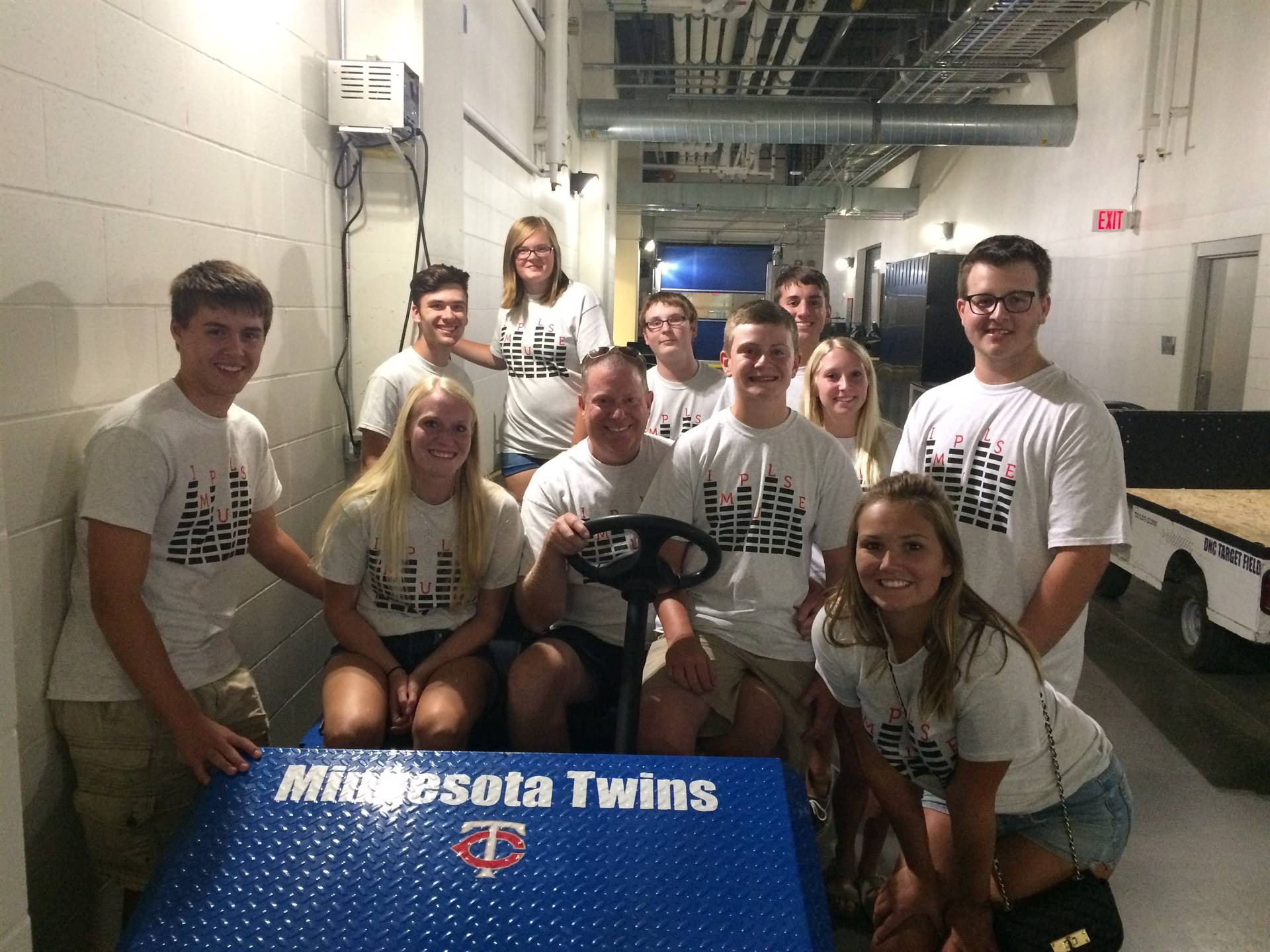 Students in and around a Minnesota Twins cart