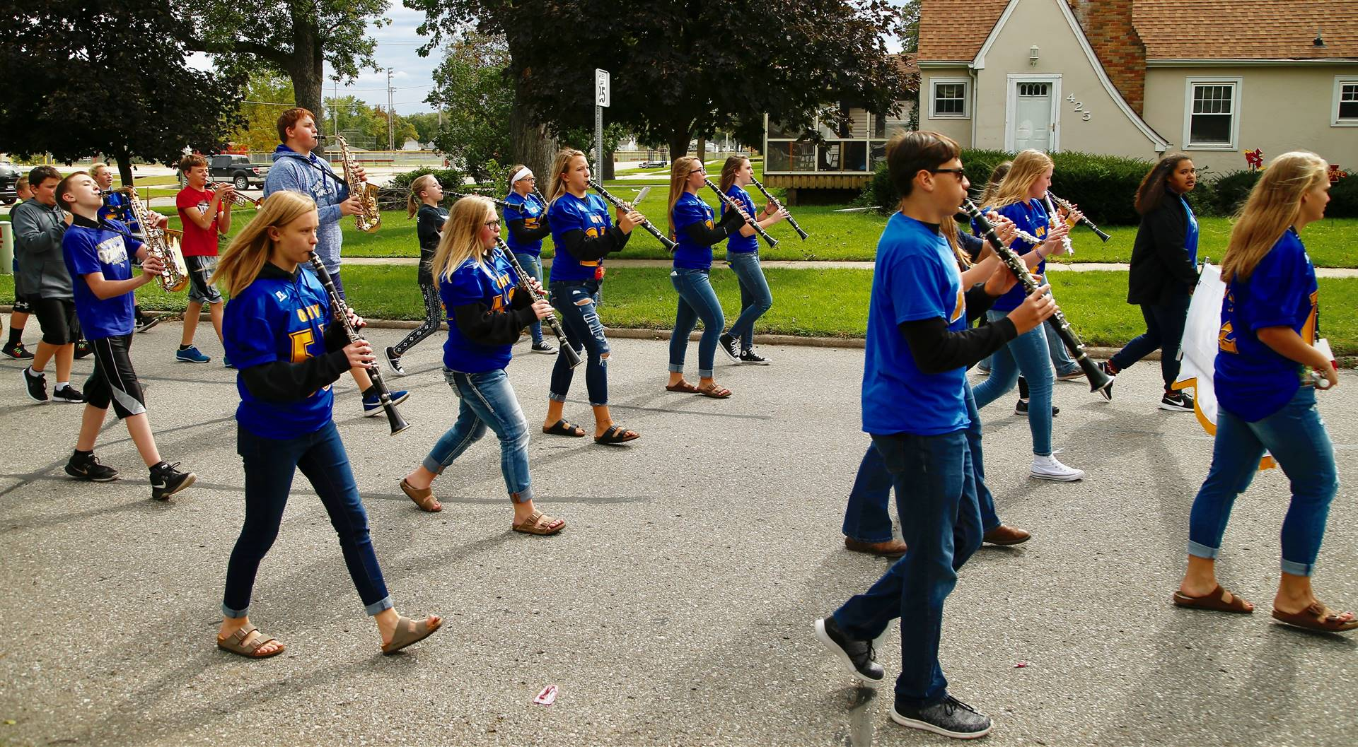 junior high students in a marching band in a parade