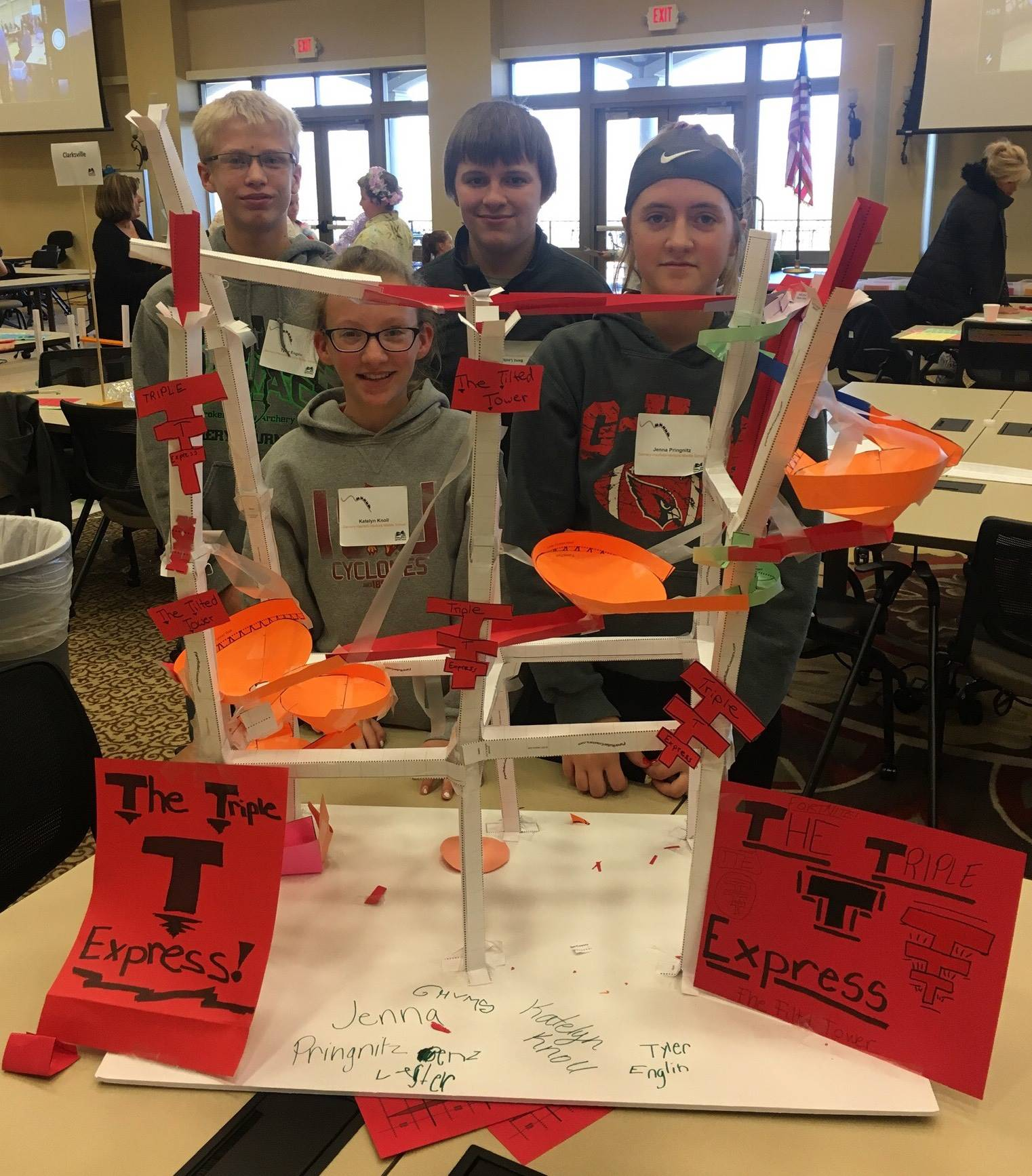 Students participating in a paper roller coaster competition