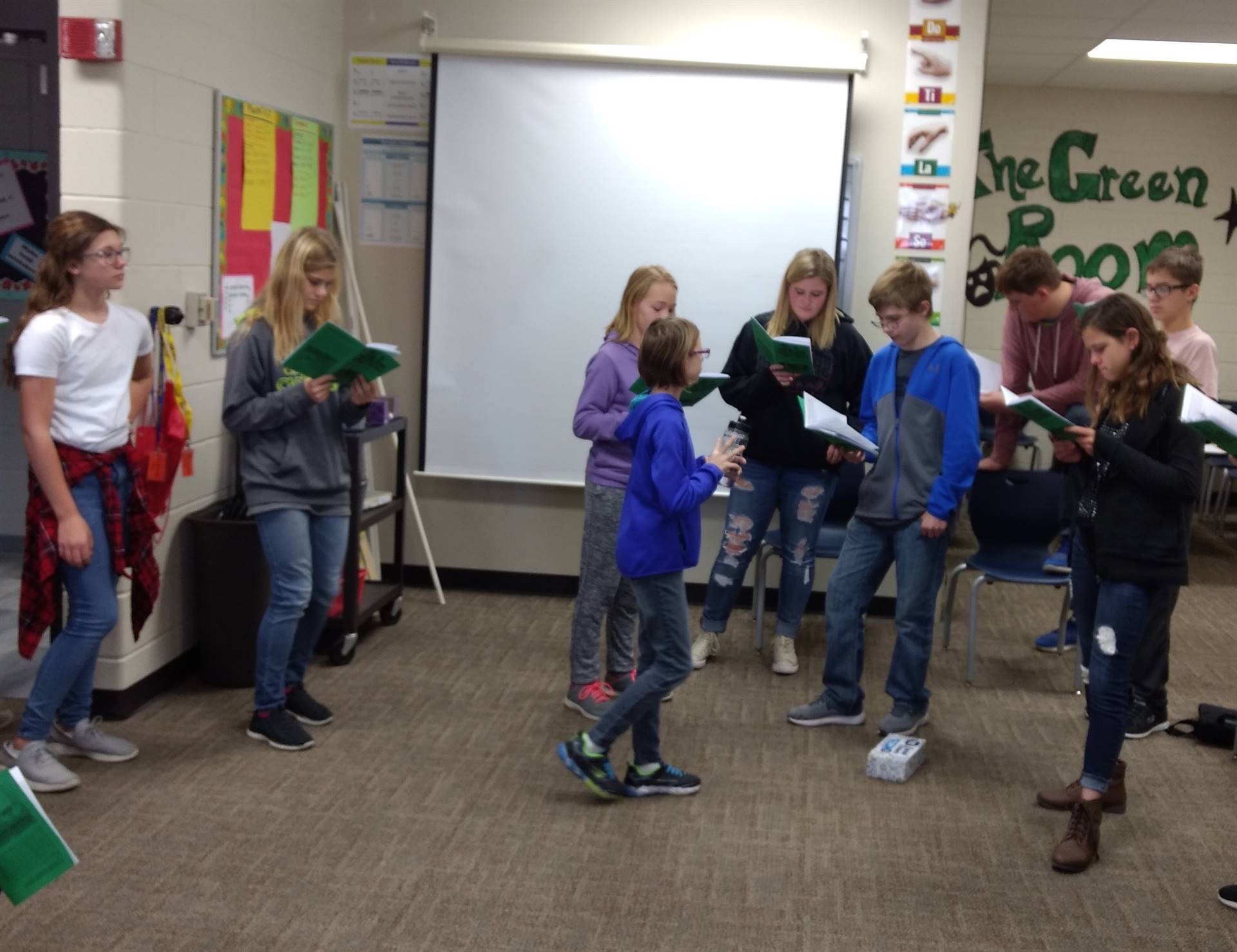 students practicing lines for a play