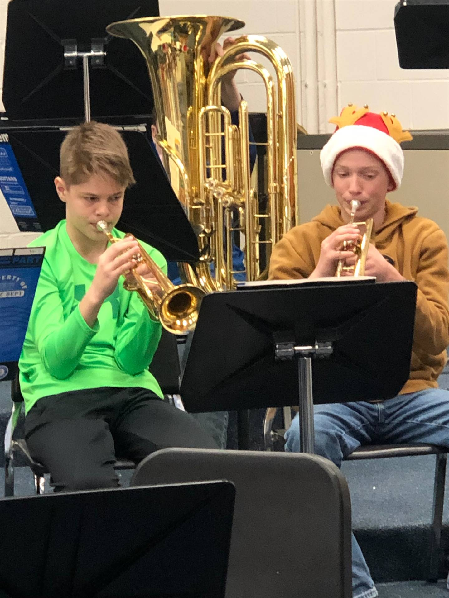 Two boys playing during band class