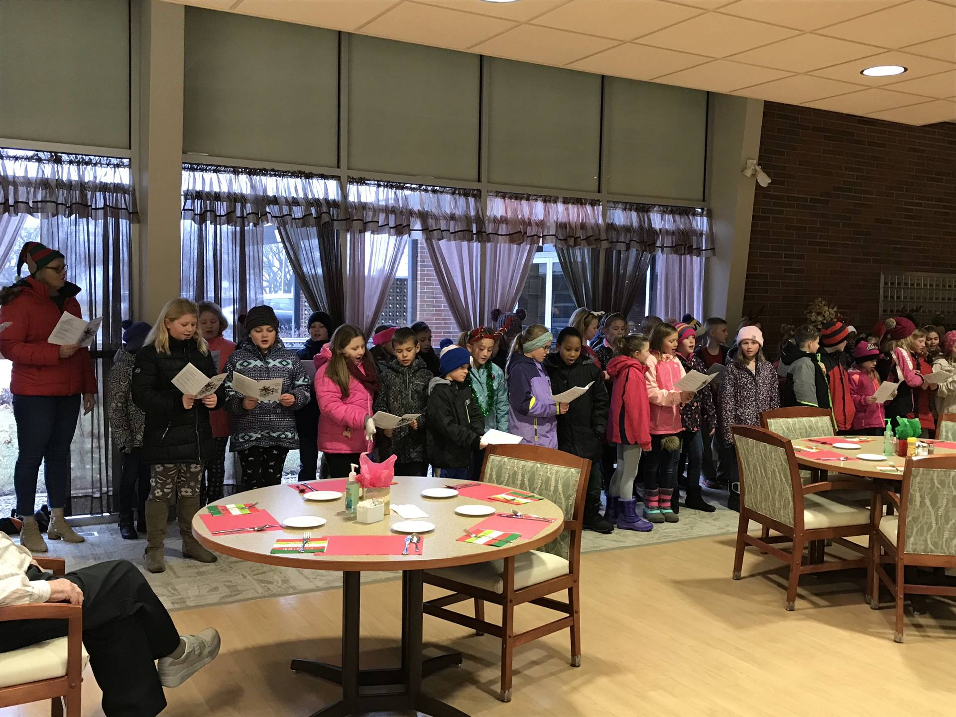 students singing at retirement home
