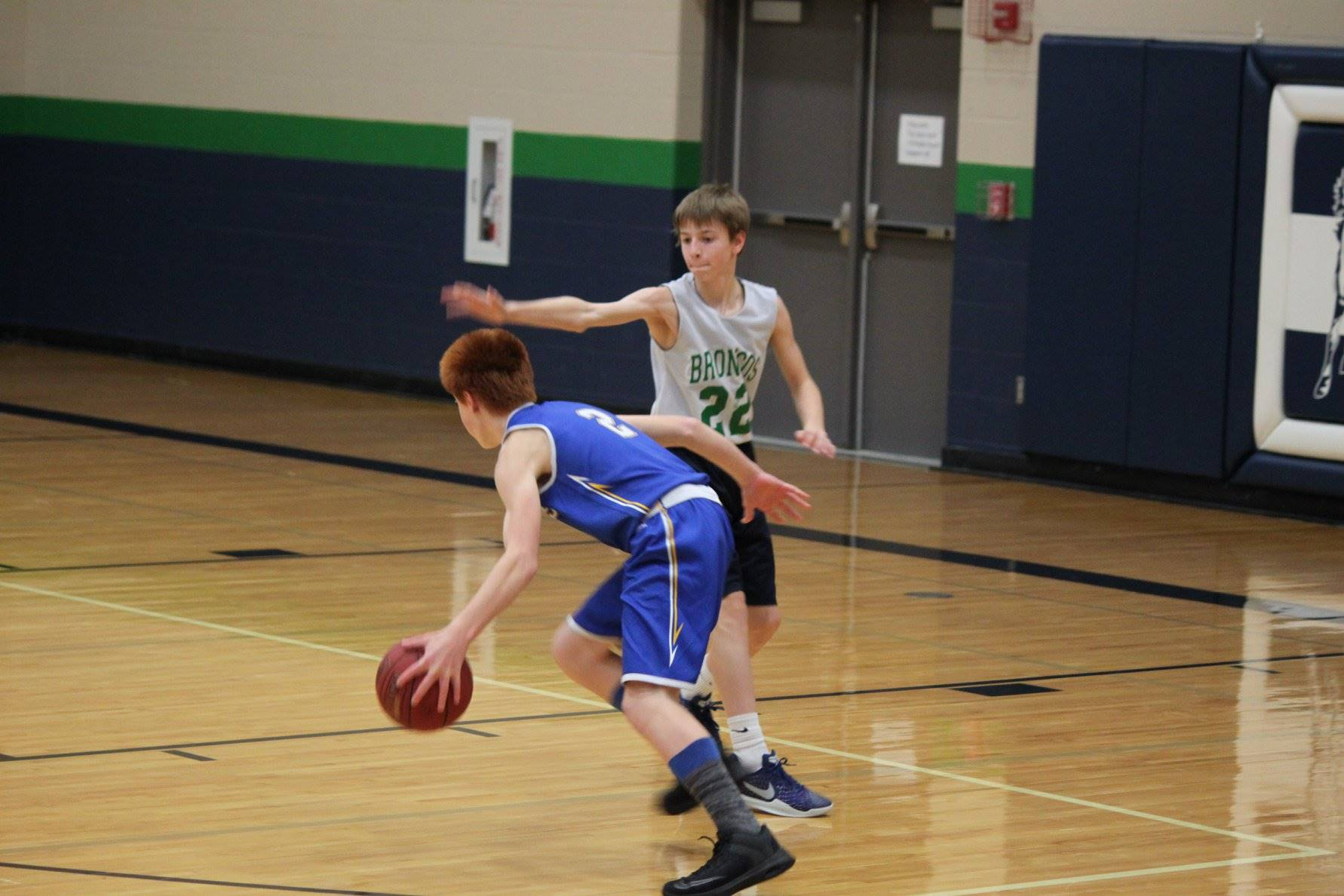 A boy dribbling a basketball