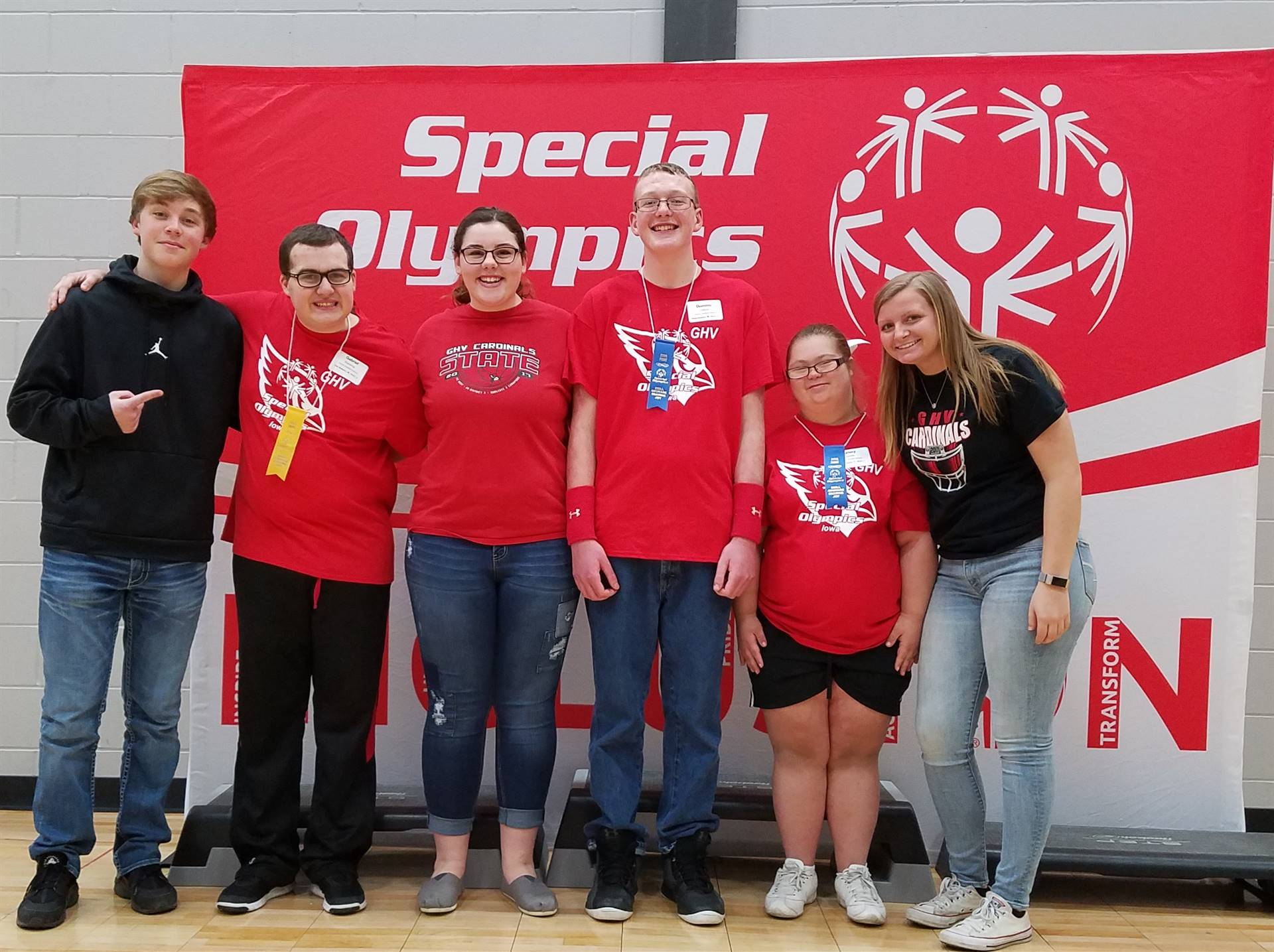 Six students posing by special olympics sign