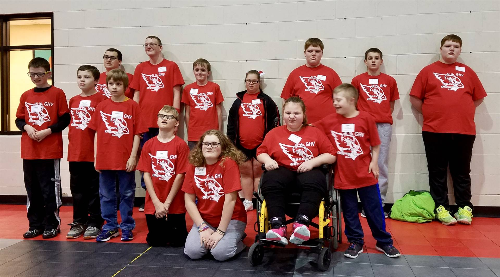 Students in red GHV Special Olympic t-shirts standing together for a photo