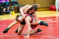 Wrestlers on the wrestling mat competing