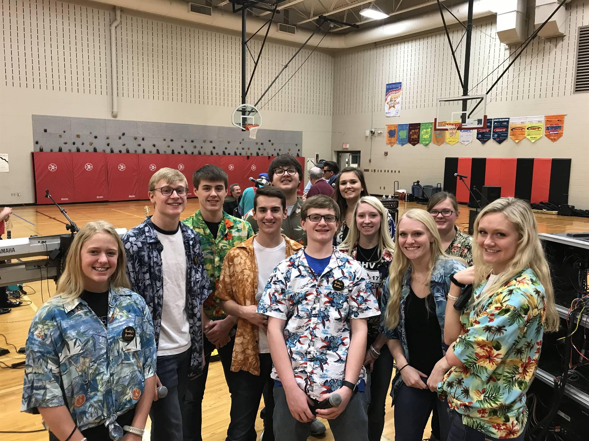 vocal jazz students dressed in tropical shirts