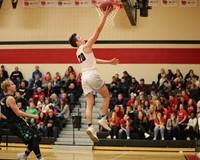 Basketball player shooting a layup