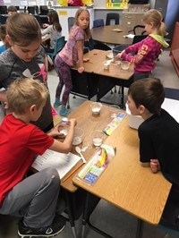 Elementary students working with Play-Doh