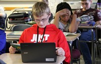 A boy doing an assignment on his Chromebook