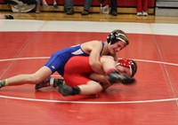 Two junior high wrestlers during a match