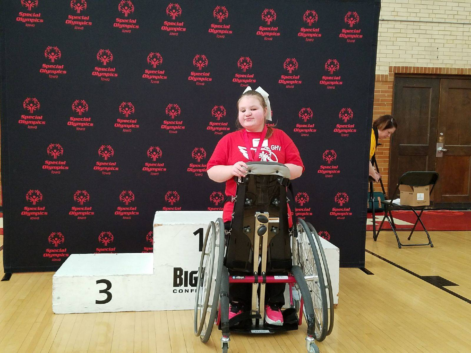 Girl in wheelchair with gold medal at the State Special Olympics