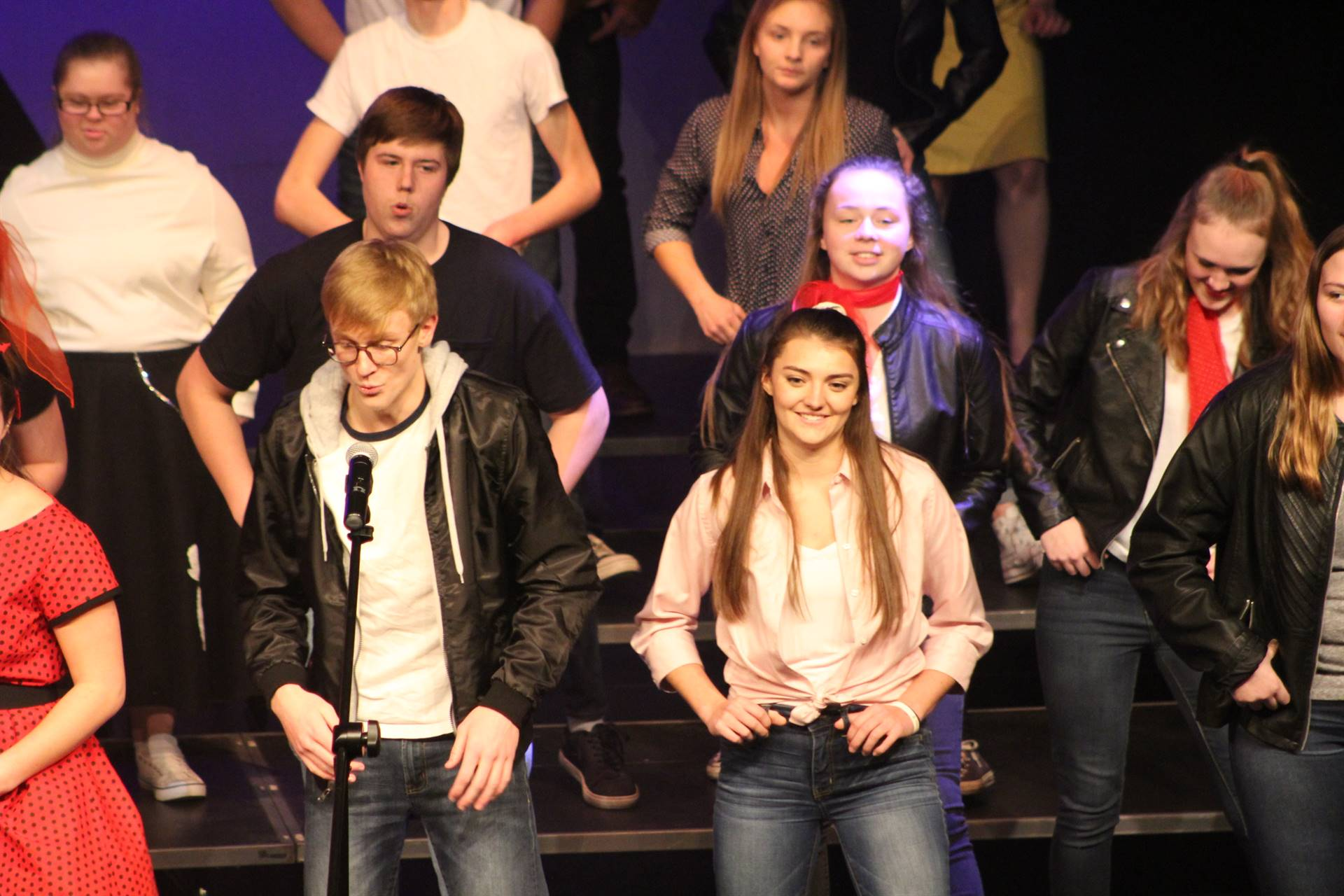 High school students singing and dancing on stage