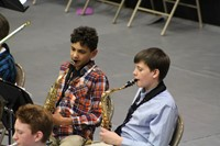 Two junior high boys playing the saxophone