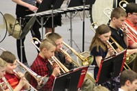 A group of intermediate students performing in a band concert