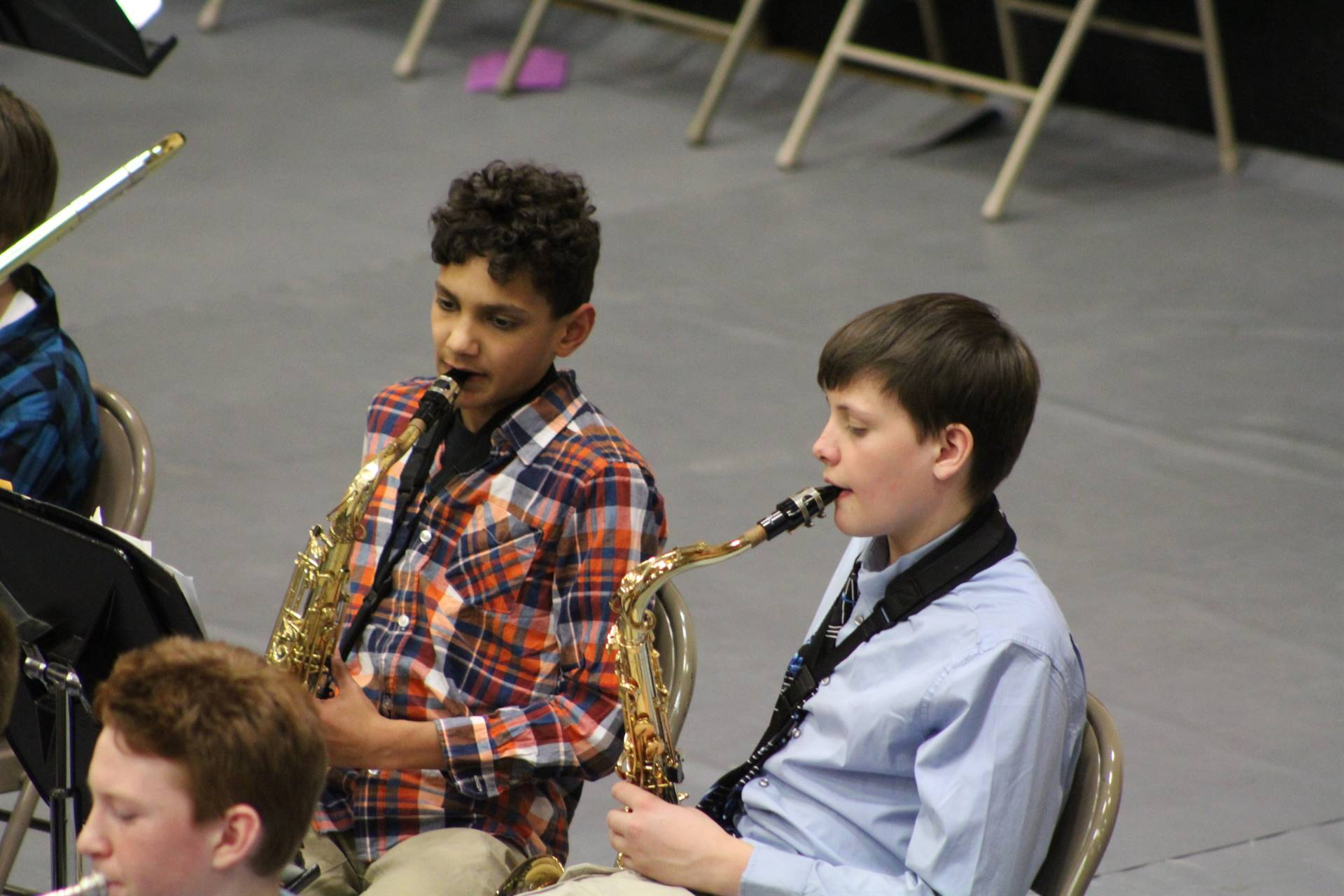 Two boys performing during a band concert