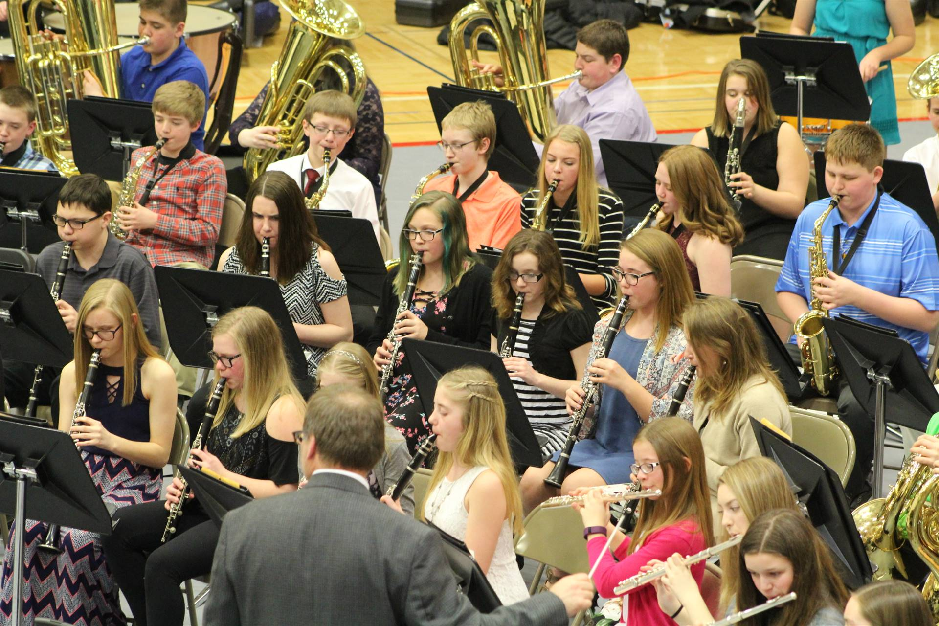 A group of junior high student performing at a band concert