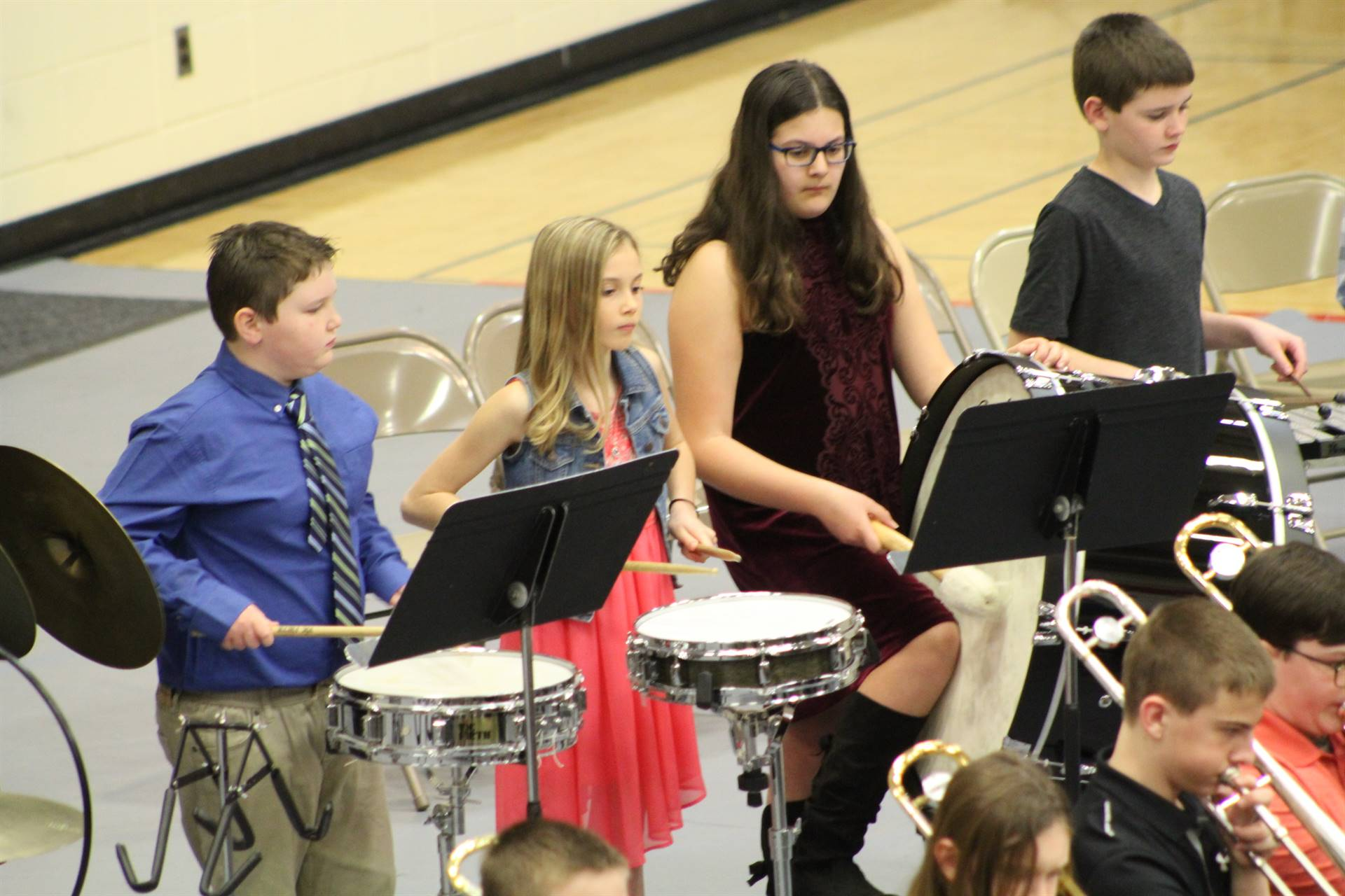 Four percussionists performing at a band concert