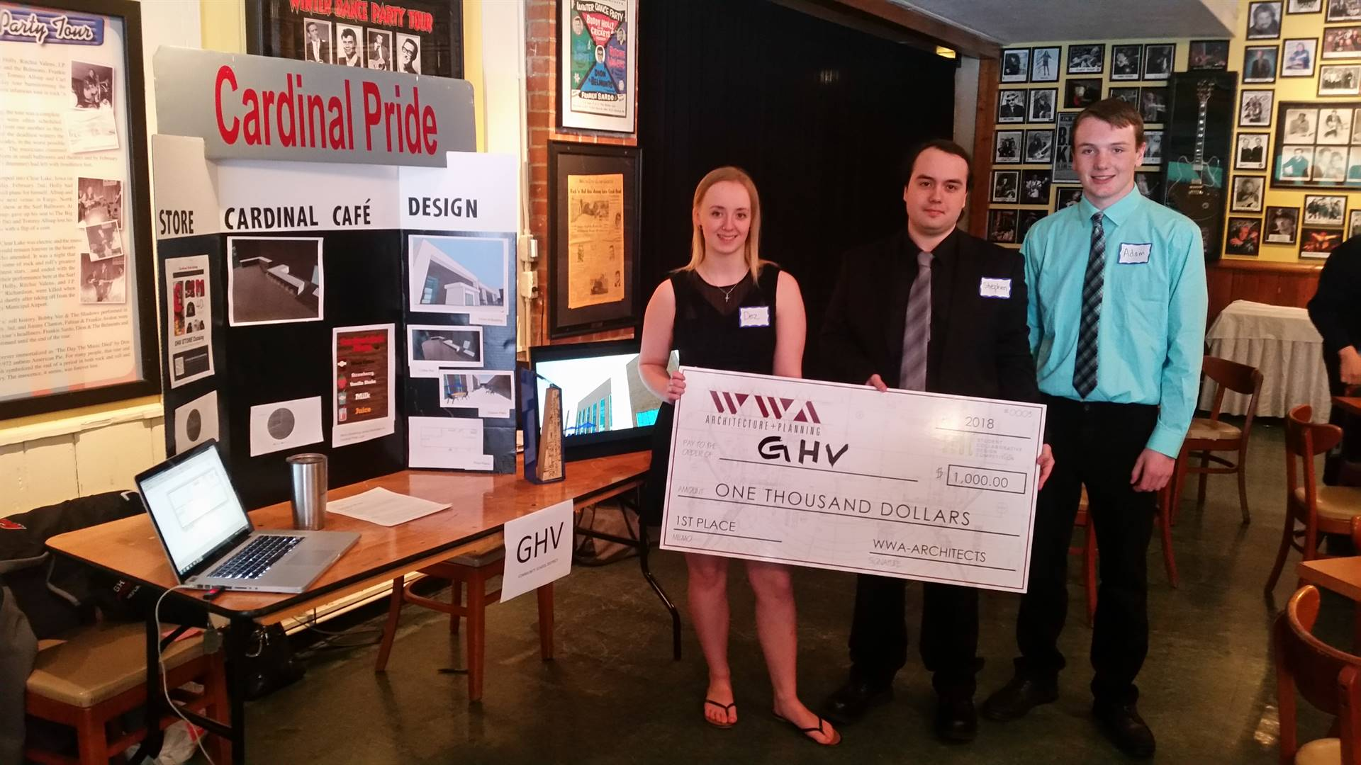 Three high school students holding a large $1000 check for 1st place in CAD competition