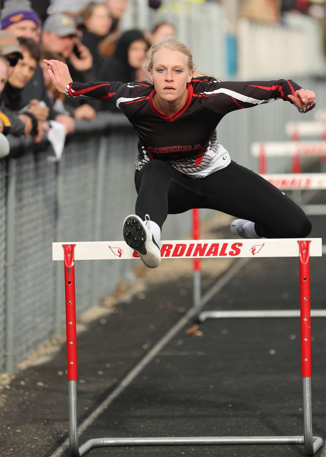 Hurdler clearing a hurdle