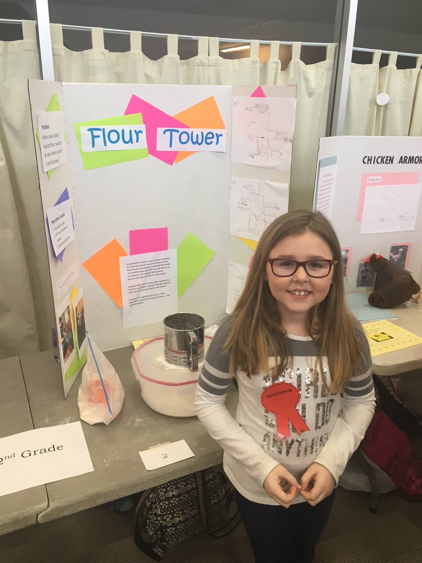 Student standing near her invention; receiving first place at regional invention convention