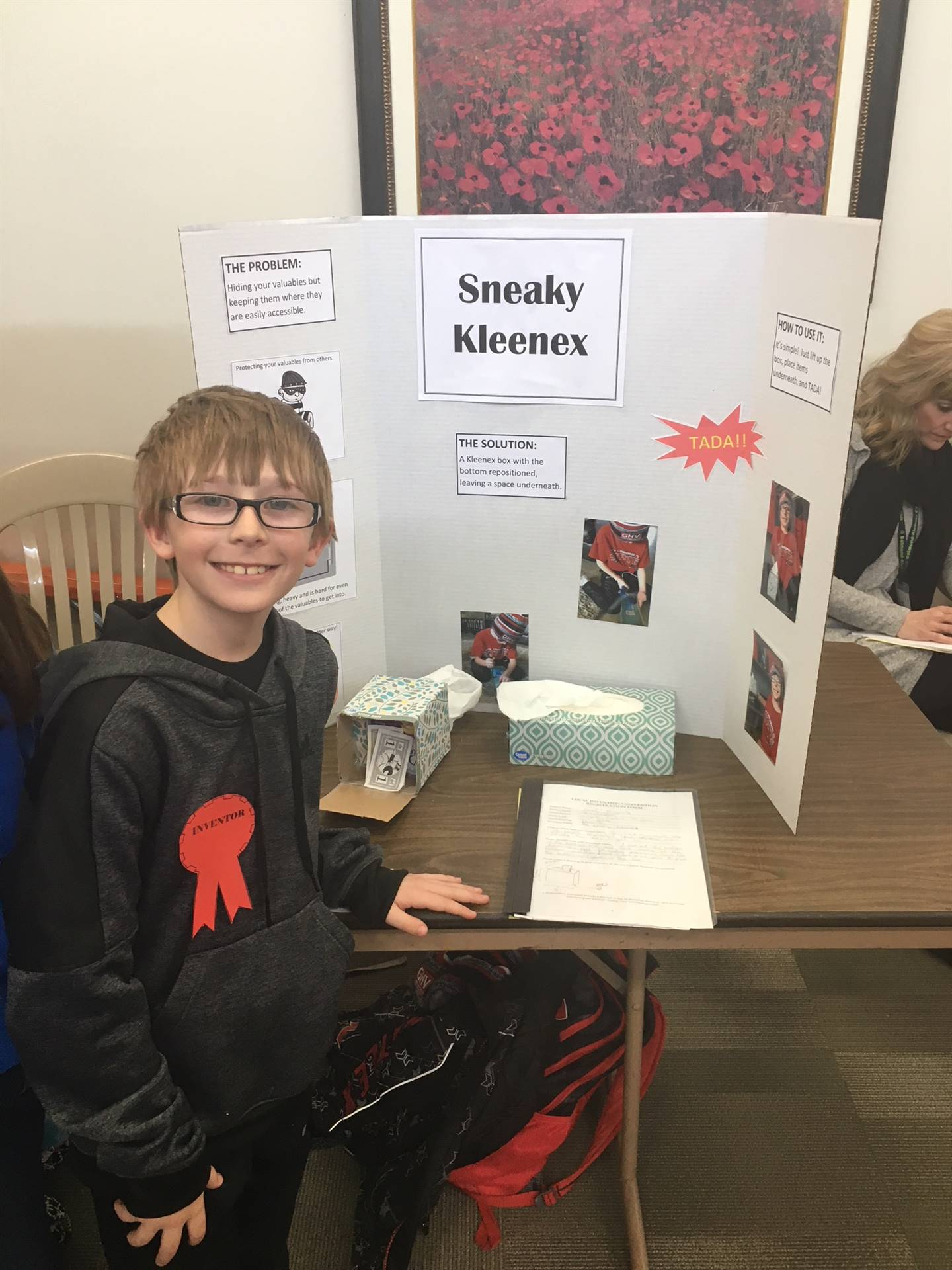 Student standing near his invention; receiving first place at regional invention convention