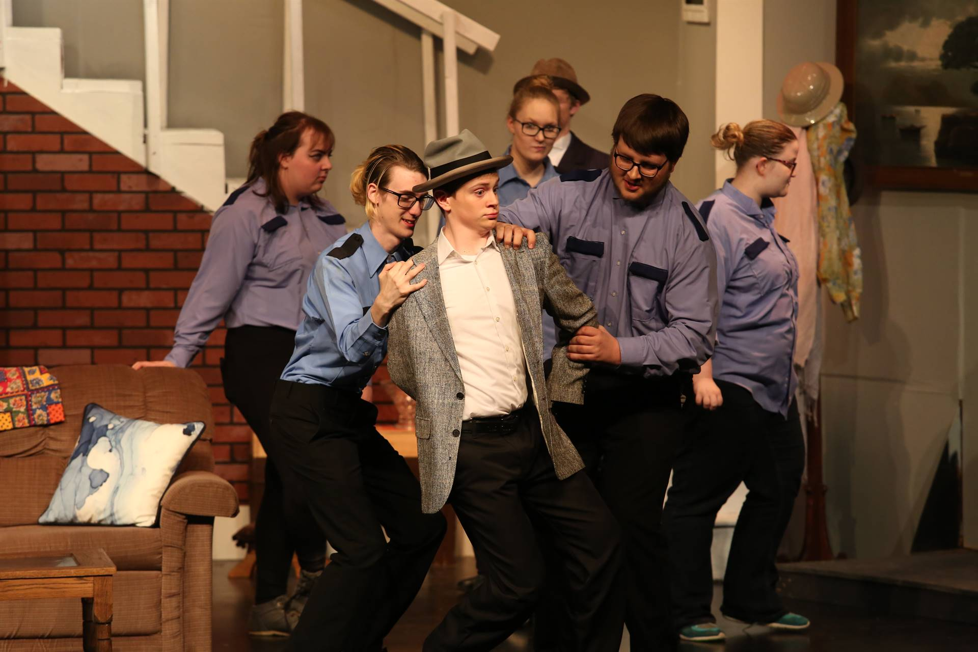 High school actors on stage performing in the play Arsenic and Old Lace