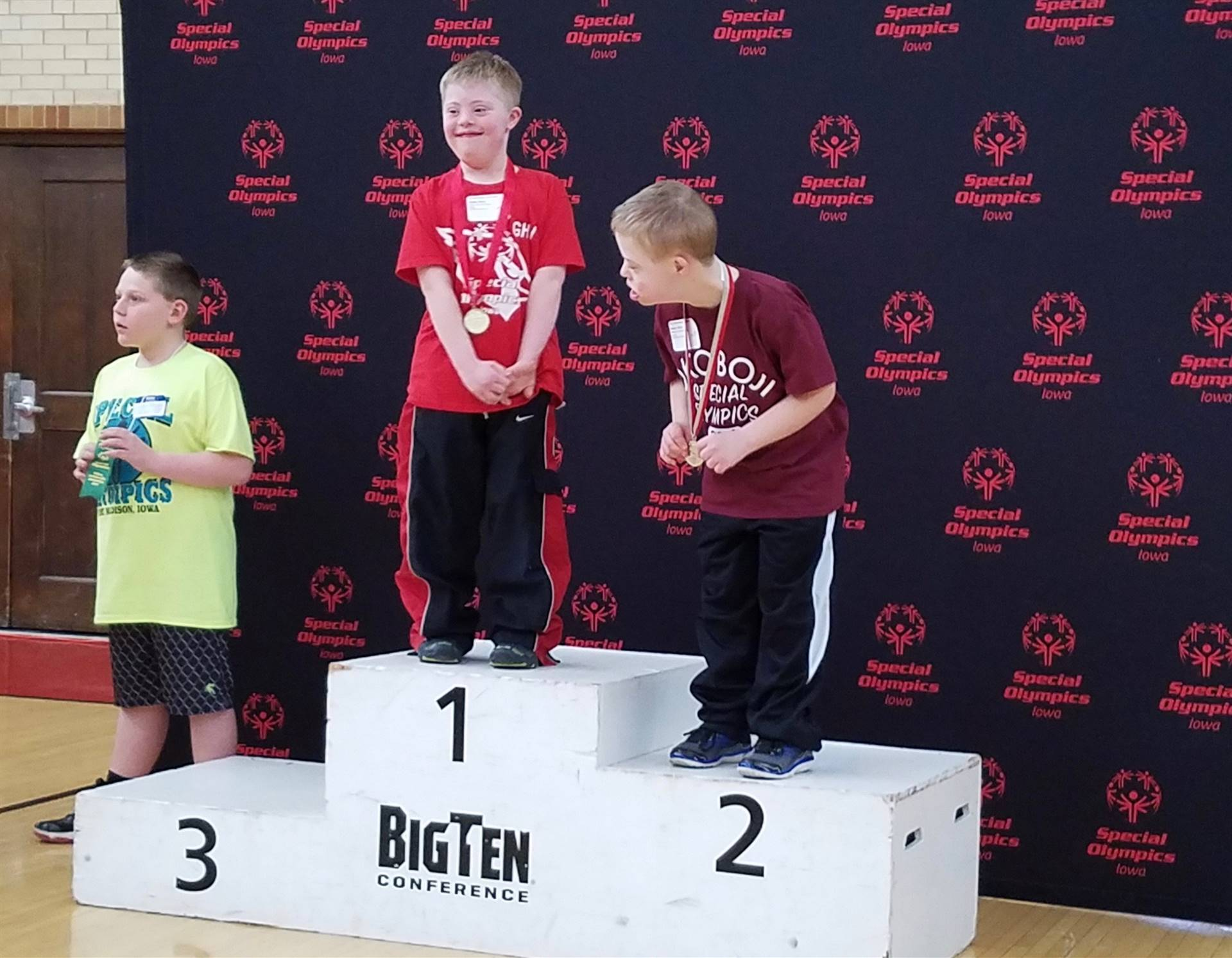 Special Olympics elementary students on podium