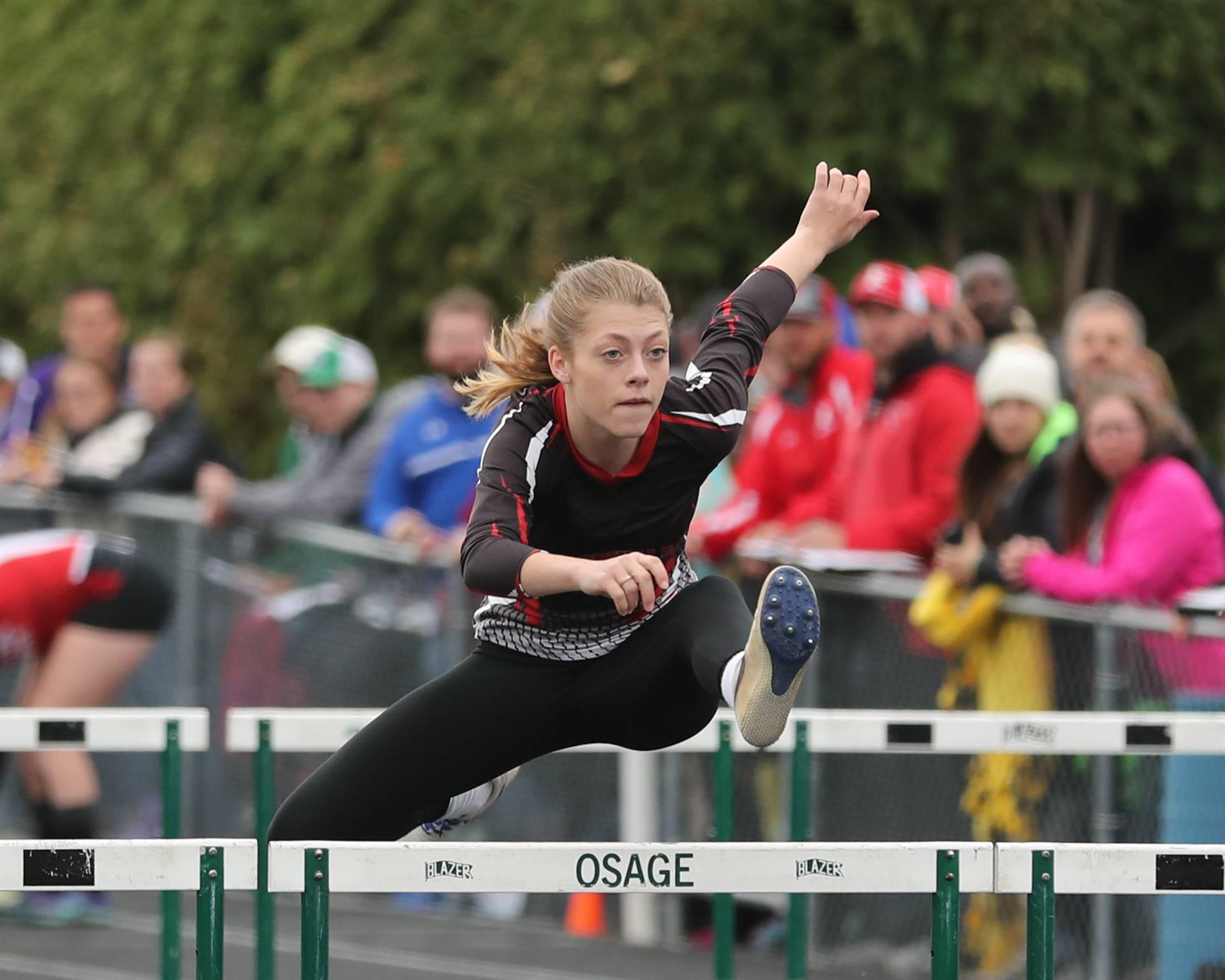 Runner hurdling a hurdle