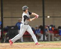 Baseball batter swings at a pitch