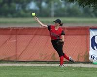 Centerfielder throws the softball